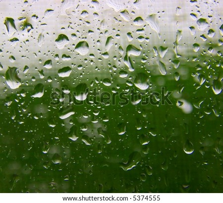 Many raindrops on the window surface - stock photo
