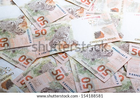 Many real fifties. Very Brazilian money. Millionaire with real - stock photo