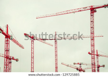 many red cranes in the sky - stock photo