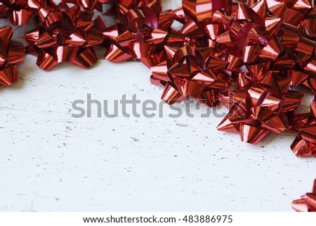 Many red decorative bows for Christmas or other gifts, with copy space.