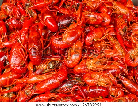Many red lobsters for sale in a market in Shanghai - stock photo