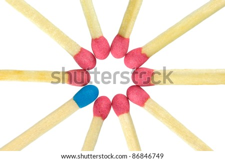 Many red matches on a white background. They are located on a circle. One match dark blue.