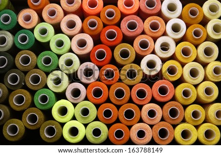 many reels of threads for embroidery, colorful, large, background - stock photo