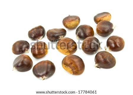 many ripe chestnuts - isolated on white background