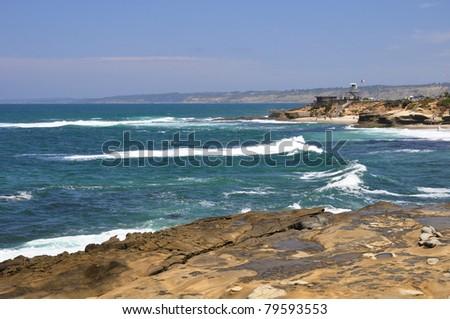 Many rocky ledges create tide pools along the shoreline in La Jolla, California. - stock photo