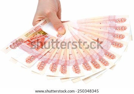 many 5000 rouble bills (the biggest Russian bond) in a hand - stock photo