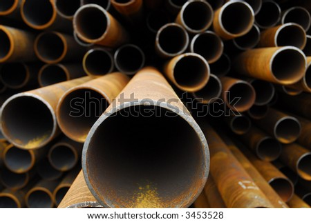 Many rusty pipes of Russian factory - stock photo