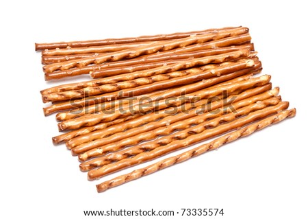 many salted sticks over a white background