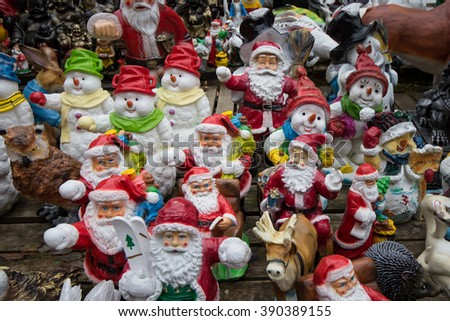 many santa claus figures, christmas background - stock photo