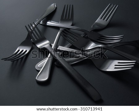 Many scattered old forks - stock photo