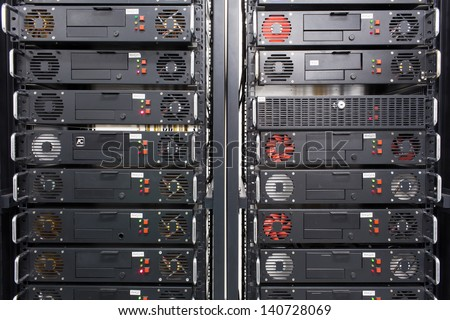 Many servers in a data center - stock photo