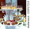 many servings of sweet tasty dessert on buffet - stock photo