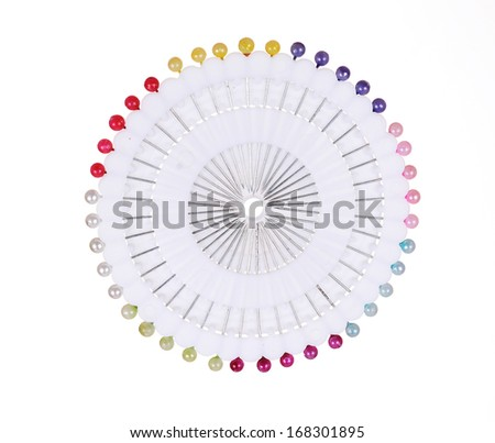 Many sewing push pins isolated - stock photo