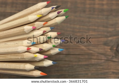 Many Sharp Color Pencil On The Empty Brown Wood Blank Background, Close Up, Concept Image, - stock photo