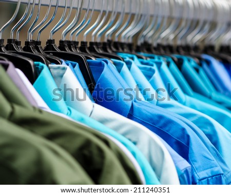 Many shirts hanging on a rack - stock photo