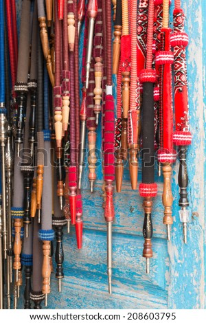 Many Shisha Pipes Hanging in Shop Door - stock photo