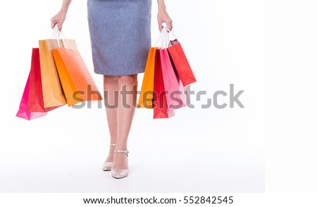 Many shopping bag in women hands after clearance sale with a copy space isolated on white background