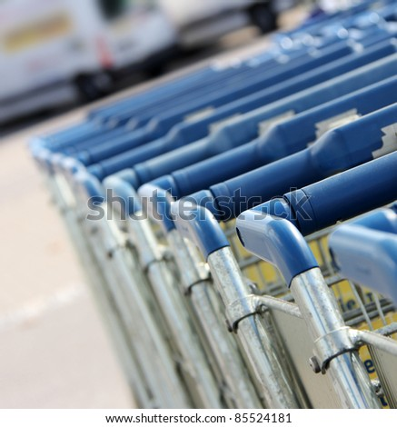 many shopping carts in a row are waiting for using - stock photo