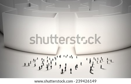 Many silhouettes of business people near entrance to labyrinth - stock photo