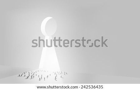 Many silhouettes of people and keyhole doorway - stock photo
