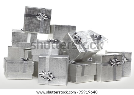 Many silver gifts in a pile - stock photo