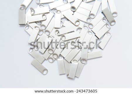 many silver usb flashes on paper - stock photo