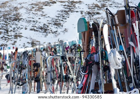 Many skis grouped near a ski resort. - stock photo