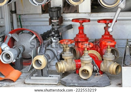 many Sleeve valves and fire lances of trucks of firefighters during a fire drill - stock photo