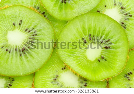 Many slices of kiwi fruit texture as background. - stock photo