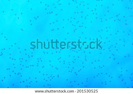 Many small air bubbles in dark blue water