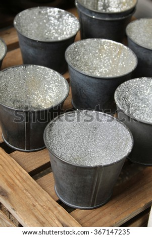 Many small decorative buckets with sequins. Interior - stock photo
