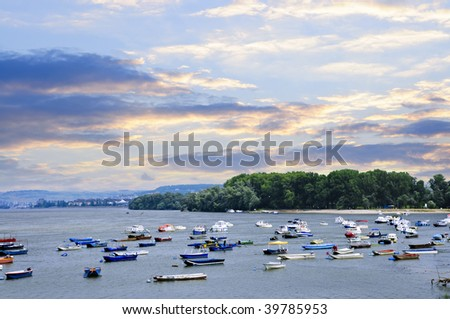 Many small fishing boats anchored on Danube river. View from Zemun part of Belgrade. - stock photo