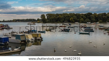 Many small fishing boats anchored on Danube river with beautiful blue sky View from Zemun part of Belgrade Serbia