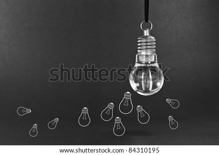 Many small ideas concept with light bulb - stock photo