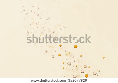 Many small oil and air bubbles flowing toward the surface - stock photo