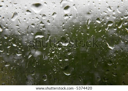 Many small raindrops on the window - stock photo