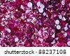Many small ruby diamond stones, luxury background - stock photo