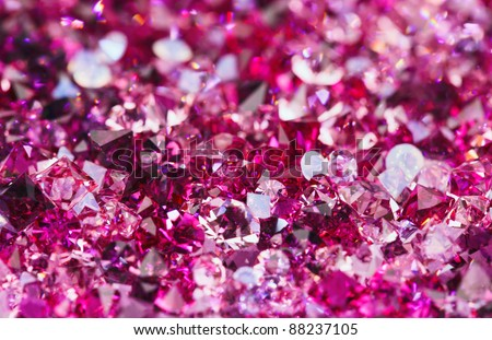 Many small ruby diamond stones, luxury background shallow depth of field - stock photo