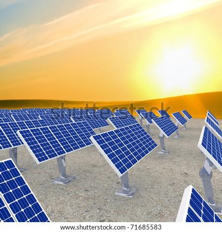 many solar energy panels against sunrise. - stock photo
