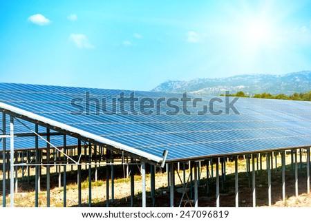 Many solar panels that produce green, environmentally friendly energy - stock photo