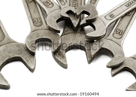 many spanners isolated on white - stock photo