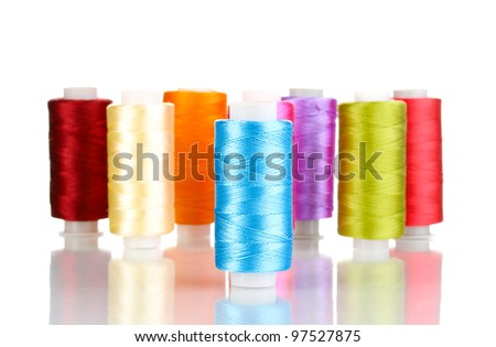 Many spools of thread isolated on white - stock photo