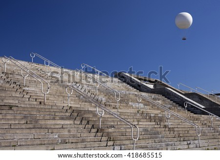 Many stairs and a balloon in blue sky  - stock photo