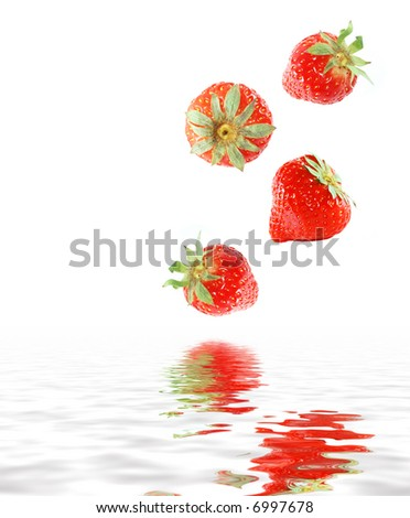many strawberries falling in water - stock photo