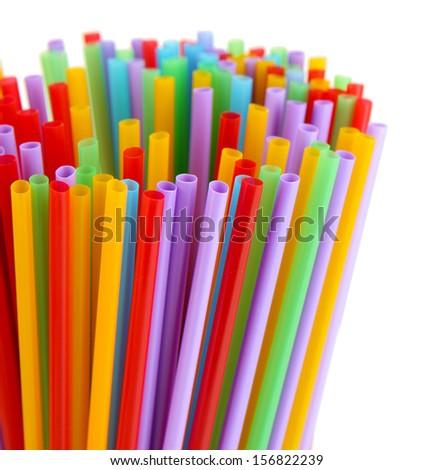 Many straws close-up isolated on white  - stock photo