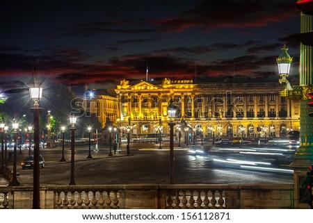 Many street lamps illuminate the Place de la Concorde at night in Paris. - stock photo