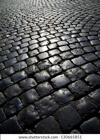 Many streets in Rome, Italy, are paved with cobblestones. - stock photo
