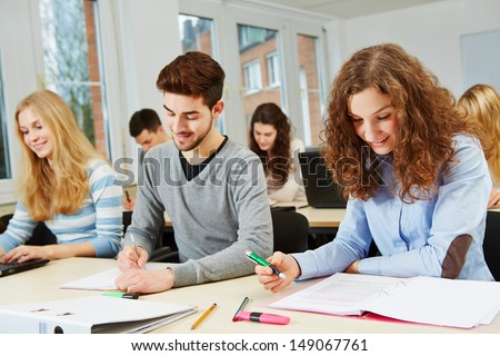 Many students in university course studying and learning