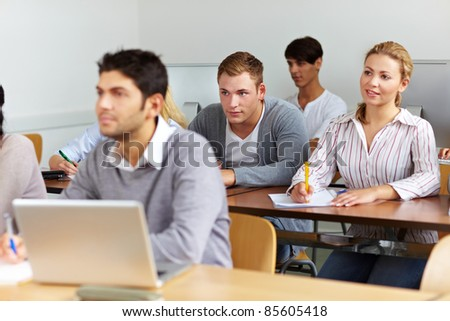 Many students learning in a university class - stock photo