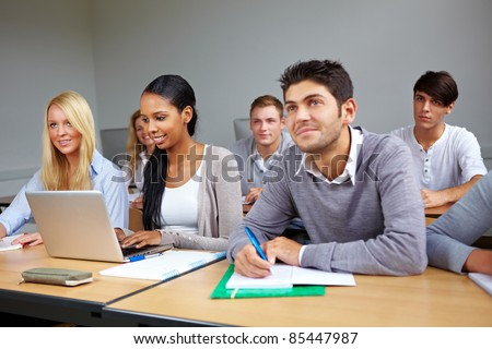 Many students listening in a university class - stock photo
